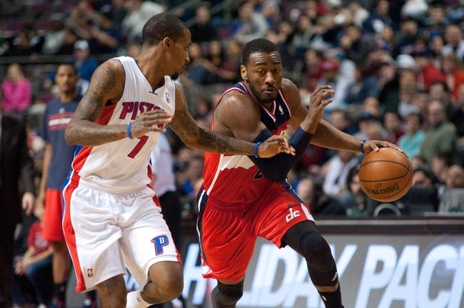 Dec 30, 2013; Auburn Hills, MI, USA; Detroit Pistons point guard Brandon Jennings (7) guards Washington Wizards point guard John Wall (2) during the fourth quarter at The Palace of Auburn Hills. Washington won 106-99. Mandatory Credit: Tim Fuller-USA TODAY Sports