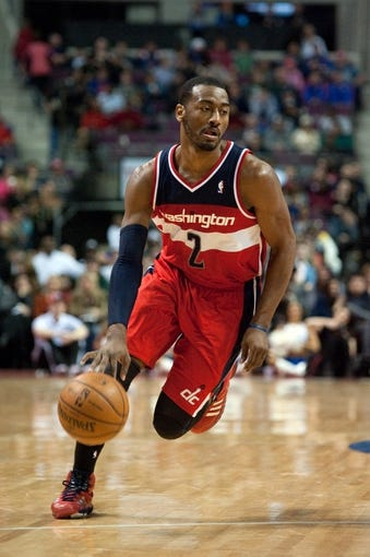 Dec 30, 2013; Auburn Hills, MI, USA; Washington Wizards point guard John Wall (2) during the fourth quarter against the Detroit Pistons at The Palace of Auburn Hills. Washington won 106-99. Mandatory Credit: Tim Fuller-USA TODAY Sports