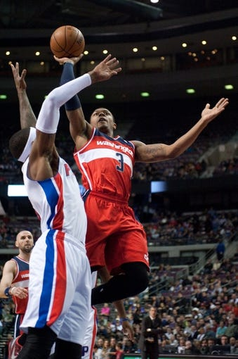 Dec 30, 2013; Auburn Hills, MI, USA; Washington Wizards shooting guard Bradley Beal (3) goes to the basket against Detroit Pistons small forward Josh Smith (6) during the third quarter at The Palace of Auburn Hills. Washington won 106-99. Mandatory Credit: Tim Fuller-USA TODAY Sports