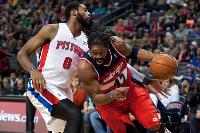 Dec 30, 2013; Auburn Hills, MI, USA; Detroit Pistons center Andre Drummond (0) guards Washington Wizards power forward Nene Hilario (42) during the fourth quarter at The Palace of Auburn Hills. Washington won 106-99. Mandatory Credit: Tim Fuller-USA TODAY Sports