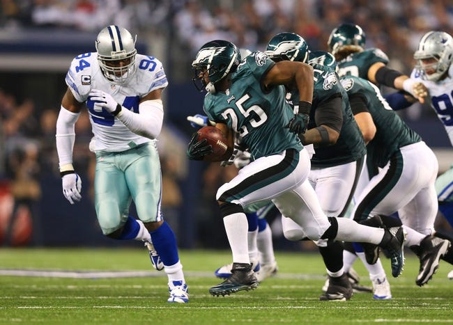Dec 29, 2013; Arlington, TX, USA; Philadelphia Eagles running back LeSean McCoy (25) runs with the ball against Dallas Cowboys defensive end DeMarcus Ware (94) at AT&T Stadium. Mandatory Credit: Matthew Emmons-USA TODAY Sports