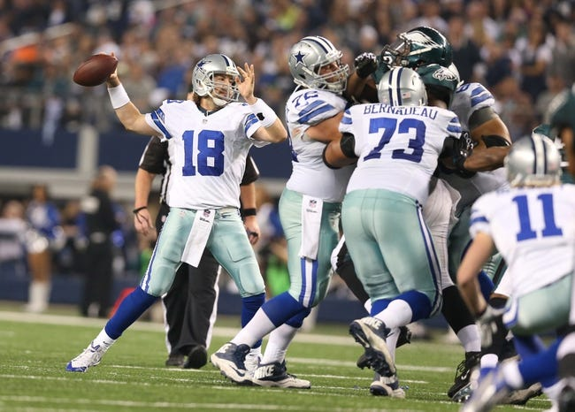 Dec 29, 2013; Arlington, TX, USA; Dallas Cowboys quarterback Kyle Orton (18) throws in the pocket against the Philadelphia Eagles at AT&T Stadium. Mandatory Credit: Matthew Emmons-USA TODAY Sports