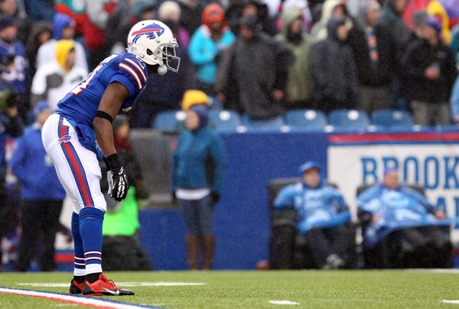 Dec 22, 2013; Orchard Park, NY, USA; Buffalo Bills cornerback Leodis McKelvin (21) waits for a kickoff to return the ball during a game against the Miami Dolphins at Ralph Wilson Stadium. Mandatory Credit: Timothy T. Ludwig-USA TODAY Sports