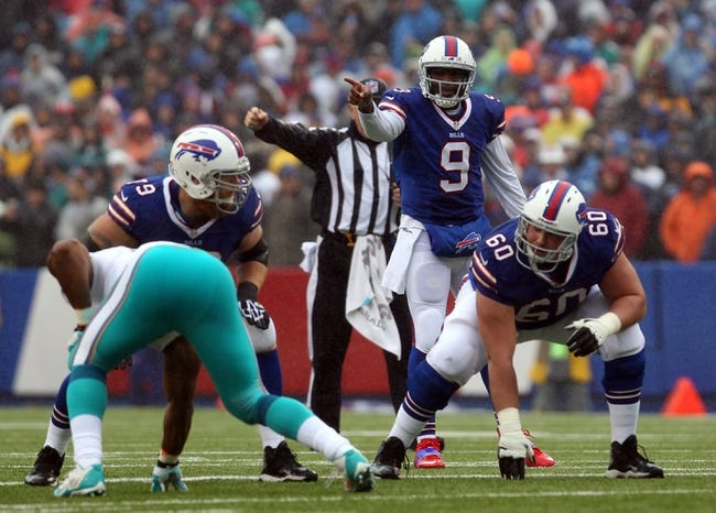 Dec 22, 2013; Orchard Park, NY, USA; Buffalo Bills quarterback Thad Lewis (9) calls a play against the Miami Dolphins at Ralph Wilson Stadium. Mandatory Credit: Timothy T. Ludwig-USA TODAY Sports