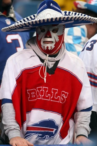 Dec 22, 2013; Orchard Park, NY, USA; A Buffalo Bills fan watches his team take on the Miami Dolphins at Ralph Wilson Stadium. Mandatory Credit: Timothy T. Ludwig-USA TODAY Sports