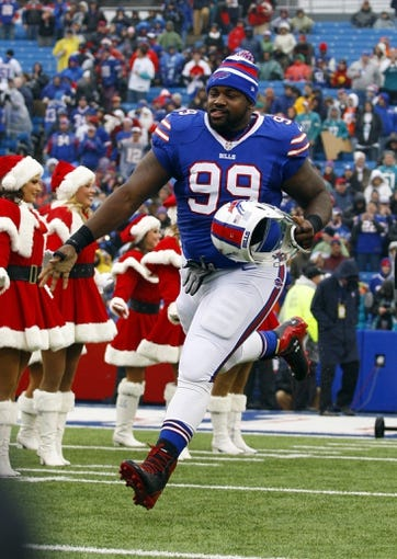 Dec 22, 2013; Orchard Park, NY, USA; Buffalo Bills defensive tackle Marcell Dareus (99) runs on the field before a game against the Miami Dolphins at Ralph Wilson Stadium. Mandatory Credit: Timothy T. Ludwig-USA TODAY Sports
