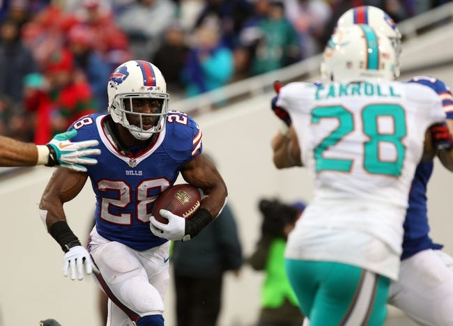 Dec 22, 2013; Orchard Park, NY, USA; Buffalo Bills running back C.J. Spiller (28) runs the ball against the Miami Dolphins at Ralph Wilson Stadium. Buffalo beats Miami 19 to 0.  Mandatory Credit: Timothy T. Ludwig-USA TODAY Sports