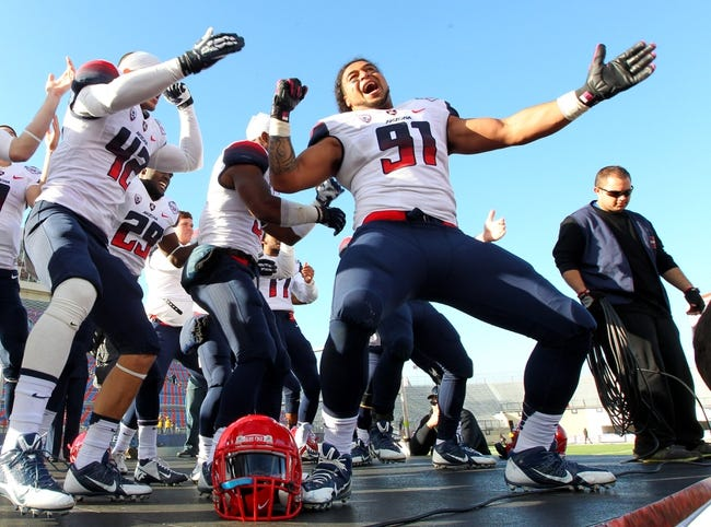 Dec 31, 2013; Shreveport, LA, USA; Arizona Wildcats defensive lineman Sione Tuihalamaka (91) leads teammates in a chant after defeating the Boston College Eagles 42-19 at Independence Stadium. Mandatory Credit: Crystal LoGiudice-USA TODAY Sports