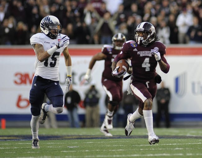 Dec 31, 2013; Memphis, TN, USA; Rice Owls cornerback Phillip Gaines (15) chases down Mississippi State Bulldogs wide receiver Jameon Lewis (4) during the second quarter at Liberty Bowl Memorial Stadium. Mandatory Credit: Justin Ford-USA TODAY Sports