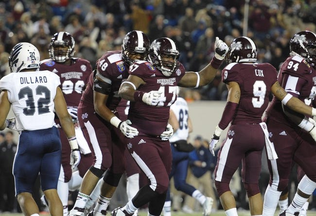 Dec 31, 2013; Memphis, TN, USA; Mississippi State Bulldogs defensive lineman A.J. Jefferson (47) celebrates after a play against the Rice Owls during the second half at Liberty Bowl Memorial Stadium. Mississippi State Bulldogs beat Rice Owls 44 - 7. Mandatory Credit: Justin Ford-USA TODAY Sports