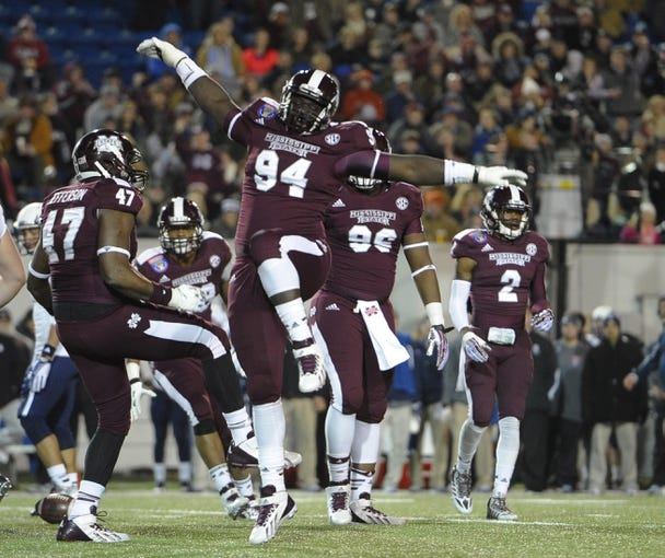 Dec 31, 2013; Memphis, TN, USA; Mississippi State Bulldogs defensive lineman Nelson Adams (94) celebrates after a play against the Rice Owls during the second half at Liberty Bowl Memorial Stadium. Mississippi State Bulldogs beat Rice Owls 44 - 7. Mandatory Credit: Justin Ford-USA TODAY Sports