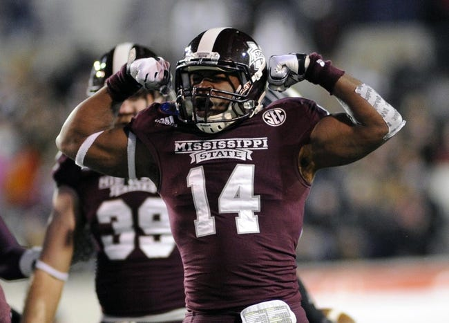 Dec 31, 2013; Memphis, TN, USA; Mississippi State Bulldogs linebacker Zach Jackson (14) celebrates after a play against the Rice Owls during the second half at Liberty Bowl Memorial Stadium. Mississippi State Bulldogs beat Rice Owls 44 - 7. Mandatory Credit: Justin Ford-USA TODAY Sports
