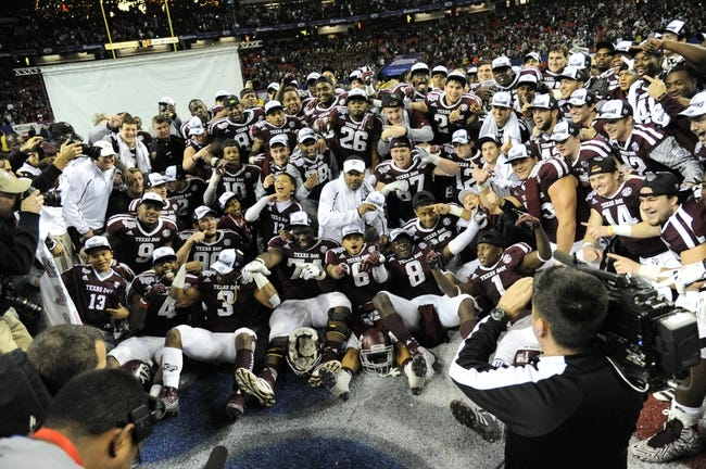 Dec 31, 2013; Atlanta, GA, USA;  Texas A&M Aggies pose for a team picture following their 52-48 victory in the 2013 Chick-fil-a Bowl against the Duke Blue Devils at the Georgia Dome. Mandatory Credit: Dale Zanine-USA TODAY Sports
