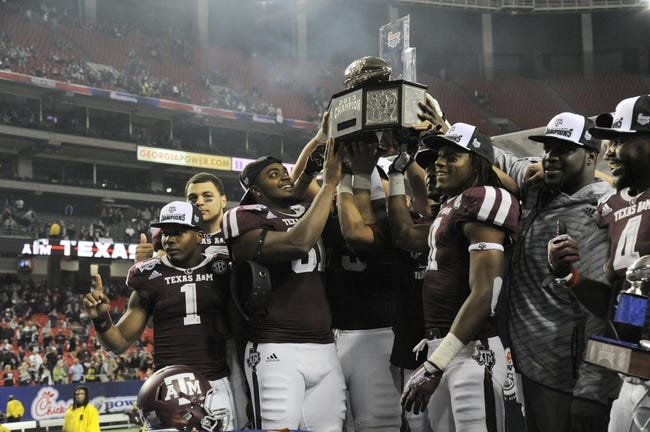 Dec 31, 2013; Atlanta, GA, USA;  Texas A&M Aggies celebrate with the trophy after defeating the Duke Blue Devils 52-48 in the 2013 Chick-fil-a Bowl at the Georgia Dome. Mandatory Credit: Dale Zanine-USA TODAY Sports
