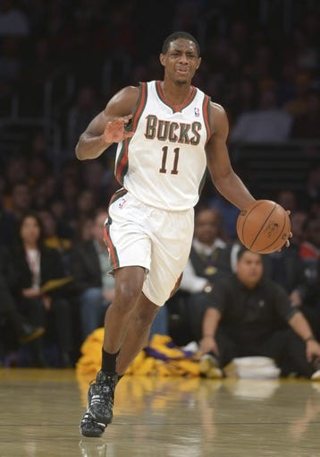 Dec 31, 2013; Los Angeles, CA, USA; Milwaukee Bucks guard Brandon Knight (11) dribbles the ball against the Los Angeles Lakers at Staples Center. The Bucks defeated the Lakers 94-79. Mandatory Credit: Kirby Lee-USA TODAY Sports