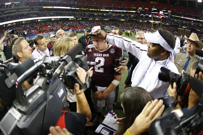 Dec 31, 2013; Atlanta, GA, USA; Texas A&M Aggies quarterback Johnny Manziel (2) and head coach Kevin Sumlin celebrate defeating the Duke Blue Devils during the 2013 Chick-fil-A Bowl at the Georgia Dome. Texas A&M won 52-48. Mandatory Credit: Paul Abell-USA TODAY Sports