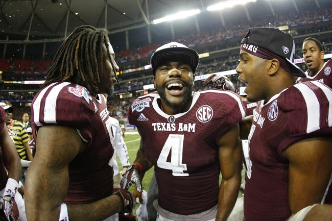 Dec 31, 2013; Atlanta, GA, USA; Texas A&M Aggies defensive back Toney Hurd Jr. (4) celebrates with his teammates after defeating the Duke Blue Devils during the 2013 Chick-fil-A Bowl at the Georgia Dome. Texas A&M won 52-48. Mandatory Credit: Paul Abell-USA TODAY Sports