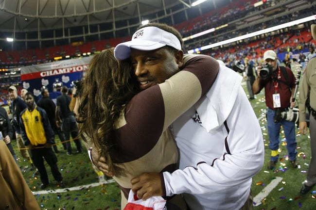 Dec 31, 2013; Atlanta, GA, USA; Texas A&M Aggies head coach Kevin Sumlin celebrates with his wife Charlene Sumlin after defeating the Duke Blue Devils during the 2013 Chick-fil-A Bowl at the Georgia Dome. Texas A&M won 52-48. Mandatory Credit: Paul Abell-USA TODAY Sports
