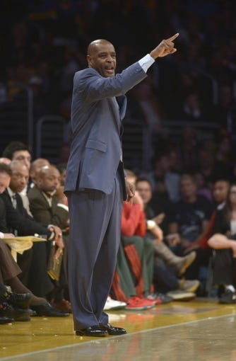 Dec 31, 2013; Los Angeles, CA, USA; Milwaukee Bucks coach Larry Drew reacts during the game against the Los Angeles Lakers at Staples Center. The Bucks defeated the Lakers 94-79. Mandatory Credit: Kirby Lee-USA TODAY Sports