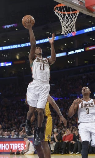 Dec 31, 2013; Los Angeles, CA, USA; Milwaukee Bucks guard Brandon Knight (11) shoots the ball against the Los Angeles Lakers during the game at Staples Center. Mandatory Credit: Kirby Lee-USA TODAY Sports
