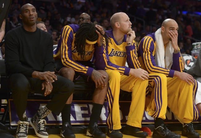 Dec 31, 2013; Los Angeles, CA, USA; Los Angeles Lakers players (from left) Kobe Bryant and Jordan Hill and Chris Kaman and Roert Sacre react in the fourth quarter against the Milwaukee Bucks at Staples Center. The Bucks defeated the Lakers 94-79. Mandatory Credit: Kirby Lee-USA TODAY Sports