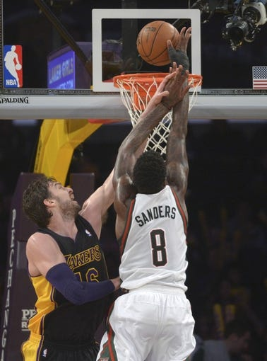 Dec 31, 2013; Los Angeles, CA, USA; Milwaukee Bucks center Larry Sanders (8) is defended by Los Angeles Lakers forward Pau Gasol (16) at Staples Center. The Bucks defeated the Lakers 94-79. Mandatory Credit: Kirby Lee-USA TODAY Sports