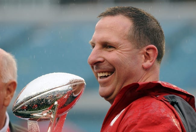 Jan 1, 2014; Jacksonville, FL, USA; Nebraska Cornhuskers head coach Bo Pelini with the trophy after the game against the Georgia Bulldogs at EverBank Field . Mandatory Credit: Melina Vastola-USA TODAY Sports