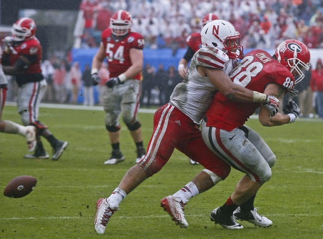 Jan 1, 2014; Jacksonville, FL, USA; Nebraska Cornhuskers linebacker David Santos (41) knocks a pass away from Georgia Bulldogs tight end Arthur Lynch (88) in the final seconds of the fourth quarter of their game at EverBank Field. The Nebraska Cornhuskers beat the Georgia Bulldogs 24-19. Mandatory Credit: Phil Sears-USA TODAY Sports