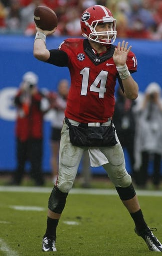 Jan 1, 2014; Jacksonville, FL, USA; Georgia Bulldogs quarterback Hutson Mason (14) throws a pass in the fourth quarter of their game against the Nebraska Cornhuskers at EverBank Field. The Nebraska Cornhuskers beat the Georgia Bulldogs 24-19. Mandatory Credit: Phil Sears-USA TODAY Sports