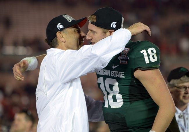Jan 1, 2014; Pasadena, CA, USA; Michigan State Spartans coach Mark Dantonio (left) and quarterback Connor Cook (18) embrace after the 100th Rose Bowl against the Stanford Cardinal. Michigan State defeated Stanford 24-20. Mandatory Credit: Kirby Lee-USA TODAY Sports
