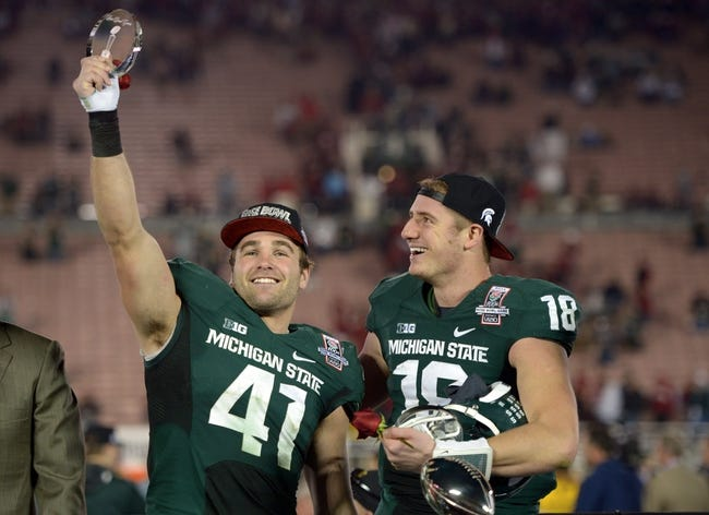 Jan 1, 2014; Pasadena, CA, USA; Michigan State Spartans linebacker Kyler Elsworth (41) and quarterback Connor Cook (18) celebrate after the 100th Rose Bowl against the Stanford Cardinal. Michigan State defeated Stanford 24-20. Mandatory Credit: Kirby Lee-USA TODAY Sports