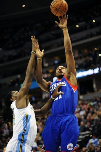 Jan 1, 2014; Denver, CO, USA; Philadelphia 76ers forward Thaddeus Young (21) shoots over Denver Nuggets forward Kenneth Faried (35) in the first quarter at Pepsi Center. Mandatory Credit: Byron Hetzler-USA TODAY Sports