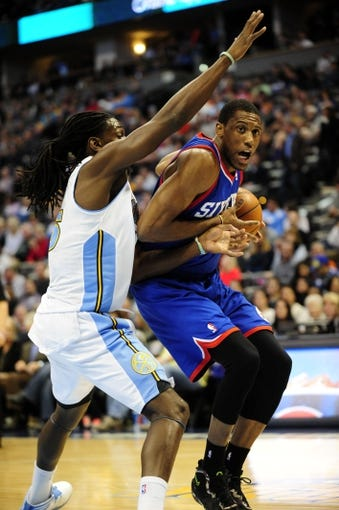 Jan 1, 2014; Denver, CO, USA; Philadelphia 76ers forward Thaddeus Young (21) drives against Denver Nuggets forward Kenneth Faried (35) in the first quarter at Pepsi Center. Mandatory Credit: Byron Hetzler-USA TODAY Sports
