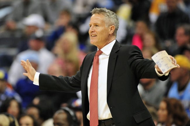 Jan 1, 2014; Denver, CO, USA; Philadelphia 76ers head coach Brett Brown gives his team instructions in the first quarter against the Denver Nuggets at Pepsi Center. Mandatory Credit: Byron Hetzler-USA TODAY Sports