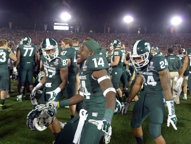 Jan 1, 2014; Pasadena, CA, USA; Michigan State Spartans receiver Tony Lippett (14) celebrates in the final minute   against the Stanford Cardinal in the 100th Rose Bowl. Michigan State defeated Stanford 24-20. Mandatory Credit: Kirby Lee-USA TODAY Sports
