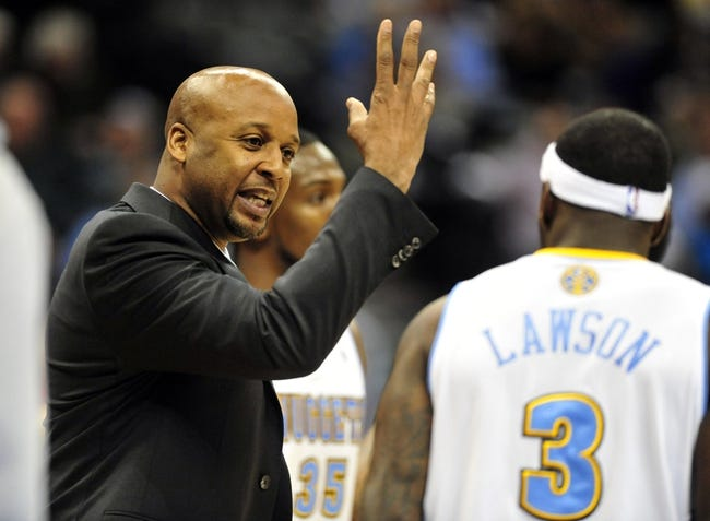 Jan 1, 2014; Denver, CO, USA; Denver Nuggets head coach Brian Shaw talks to guard Ty Lawson (3) during a timeout in the third quarter against the Philadelphia 76ers at Pepsi Center.  Philadelphia won 114-102. Mandatory Credit: Byron Hetzler-USA TODAY Sports