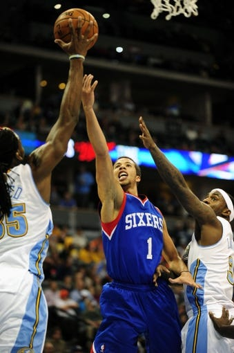 Jan 1, 2014; Denver, CO, USA; Philadelphia 76ers guard Michael Carter-Williams (1) has his shot blocked by Denver Nuggets forward Kenneth Faried (35) in the third quarter at Pepsi Center.  Philadelphia won 114-102. Mandatory Credit: Byron Hetzler-USA TODAY Sports