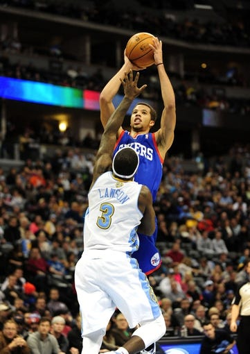 Jan 1, 2014; Denver, CO, USA; Philadelphia 76ers guard Michael Carter-Williams (1) shoots over Denver Nuggets guard Ty Lawson (3) in the third quarter at Pepsi Center.  Philadelphia won 114-102. Mandatory Credit: Byron Hetzler-USA TODAY Sports