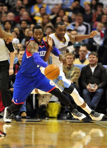 Jan 1, 2014; Denver, CO, USA; Philadelphia 76ers guard Tony Wroten (8) and Denver Nuggets forward Darrell Arthur (00) battle for control of the ball in the third quarter at Pepsi Center.  Philadelphia won 114-102. Mandatory Credit: Byron Hetzler-USA TODAY Sports