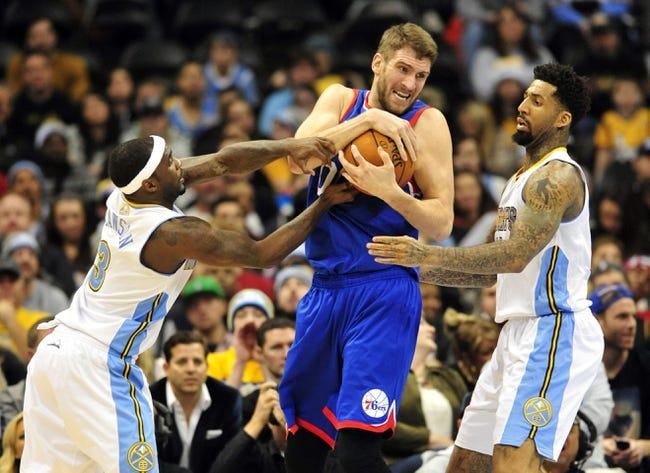 Jan 1, 2014; Denver, CO, USA; Philadelphia 76ers center Spencer Hawes (00) keeps the ball from Denver Nuggets guard Ty Lawson (3) and forward Wilson Chandler (21) in the fourth quarter at Pepsi Center.  Philadelphia won 114-102. Mandatory Credit: Byron Hetzler-USA TODAY Sports