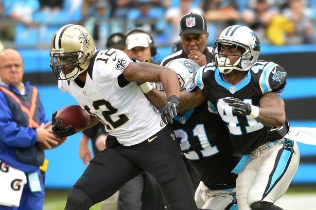 Dec 22, 2013; Charlotte, NC, USA; New Orleans Saints wide receiver Marques Colston (12) is pushed out of bounds by Carolina Panthers free safety Mike Mitchell (21) and cornerback Captain Munnerlyn (41) in the second quarter at Bank of America Stadium. Mandatory Credit: Bob Donnan-USA TODAY Sports