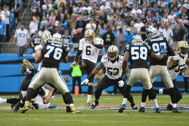 Dec 22, 2013; Charlotte, NC, USA; New Orleans Saints punter Thomas Morstead (6) punts the ball as Carolina Panthers defensive end Greg Hardy (76) and outside linebacker Thomas Davis (58) and defensive end Mario Addison (97) defend in the first quarter at Bank of America Stadium. Mandatory Credit: Bob Donnan-USA TODAY Sports