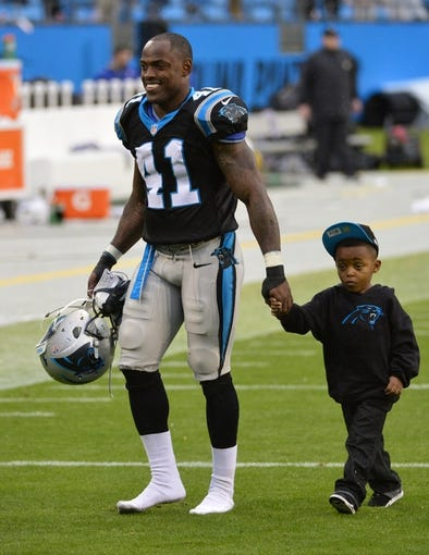 Dec 22, 2013; Charlotte, NC, USA; Carolina Panthers cornerback Captain Munnerlyn (41) walks off the field after the game. The Panthers defeated the Saint 17-13 at Bank of America Stadium. Mandatory Credit: Bob Donnan-USA TODAY Sports