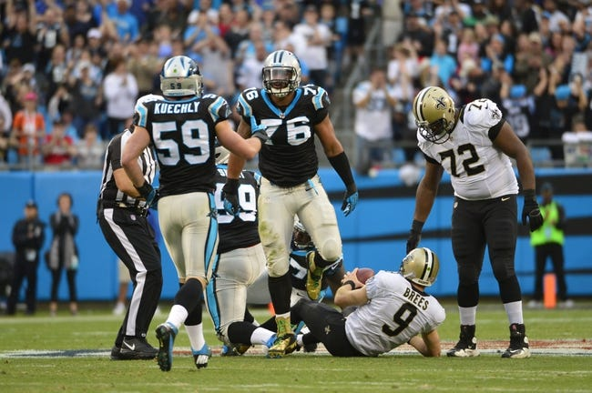 Dec 22, 2013; Charlotte, NC, USA; Carolina Panthers defensive end Greg Hardy (76) reacts with middle linebacker Luke Kuechly (59) after sacking New Orleans Saints quarterback Drew Brees (9) in the first quarter at Bank of America Stadium. Mandatory Credit: Bob Donnan-USA TODAY Sports