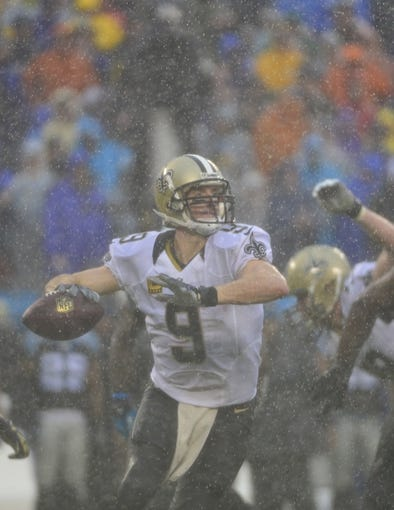 Dec 22, 2013; Charlotte, NC, USA; New Orleans Saints quarterback Drew Brees (9) looks to pass in the third quarter. The Panthers defeated the Saint 17-13 at Bank of America Stadium. Mandatory Credit: Bob Donnan-USA TODAY Sports