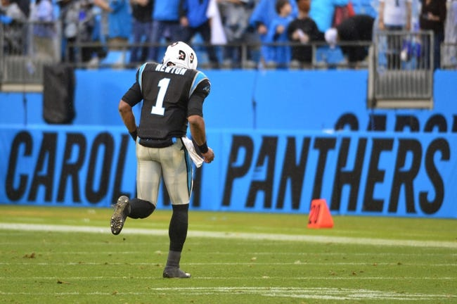 Dec 22, 2013; Charlotte, NC, USA; Carolina Panthers quarterback Cam Newton (1) runs off the field after the game. The Panthers defeated the Saints 17-13 at Bank of America Stadium. Mandatory Credit: Bob Donnan-USA TODAY Sports
