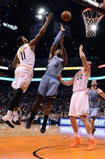 Jan 2, 2014; Phoenix, AZ, USA; Memphis Grizzlies forward James Johnson (3) lays up the ball against the Phoenix Suns forward Markieff Morris (11) and forward Miles Plumlee (22) in the first half at US Airways Center. Mandatory Credit: Jennifer Stewart-USA TODAY Sports