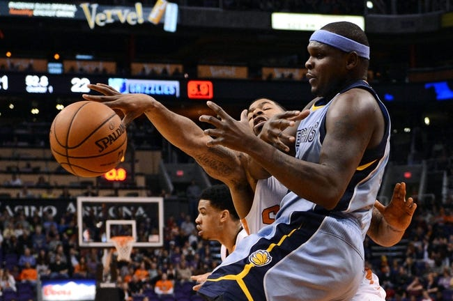 Jan 2, 2014; Phoenix, AZ, USA; Memphis Grizzlies forward Zach Randolph (50) is defended by the Phoenix Suns forward Marcus Morris (15) in the first half at US Airways Center. Mandatory Credit: Jennifer Stewart-USA TODAY Sports