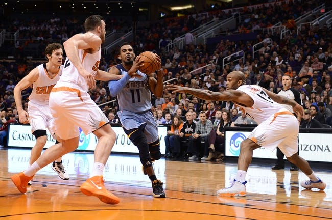 Jan 2, 2014; Phoenix, AZ, USA; Memphis Grizzlies guard Mike Conley (11) drives the ball against the Phoenix Suns forward Miles Plumlee (22) and forward P.J. Tucker (17) in the first half at US Airways Center. Mandatory Credit: Jennifer Stewart-USA TODAY Sports