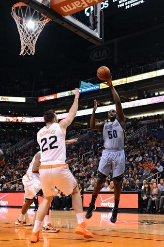 Jan 2, 2014; Phoenix, AZ, USA; Memphis Grizzlies forward Zach Randolph (50) lays up the ball against the Phoenix Suns forward Miles Plumlee (22) in the first half at US Airways Center.  The Grizzlies won 99-91. Mandatory Credit: Jennifer Stewart-USA TODAY Sports